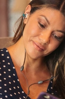 Woman Wearing Defendershield Air Tube Headsets